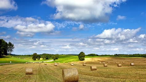farm landscape pictures download wallpaper 1600x900 farm field nature landscape hay summer cloudy sky hd background