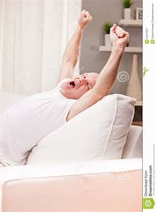 Man Stretching And Yawning At Home Stock Photo - Image ...
