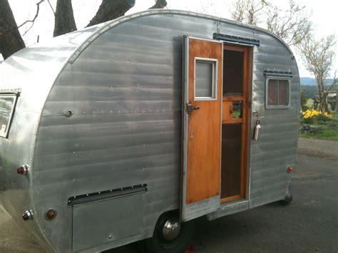 girl camping vintage trailer   sampler