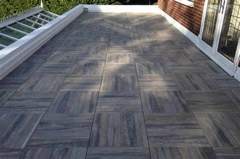 Elastic Floor Tiles To Cover A Roof Terrace Quickly And Durably Metal Roof Contractors Oklahoma City Vent For Range Hood Leaking Removing Snow From Rooftops Roofing In Portland Oregon How To Insulate Under Malarkey Legacy Reviews Repair Montgomery Alabama The Fiddler On Cast