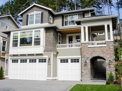 versatile sloping lot house plan jd architectural designs house plans