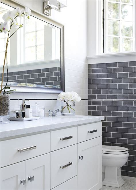 give the pristine white bathroom a cool gray accent wall