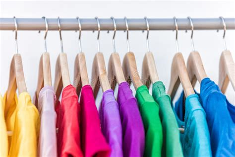 Colorful Closet by Fashion Clothes On Clothing Rack Colorful Closet Stock