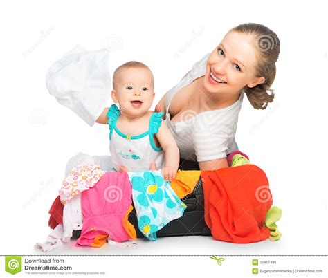 Mom And Baby Girl With Suitcase And Clothes Ready For
