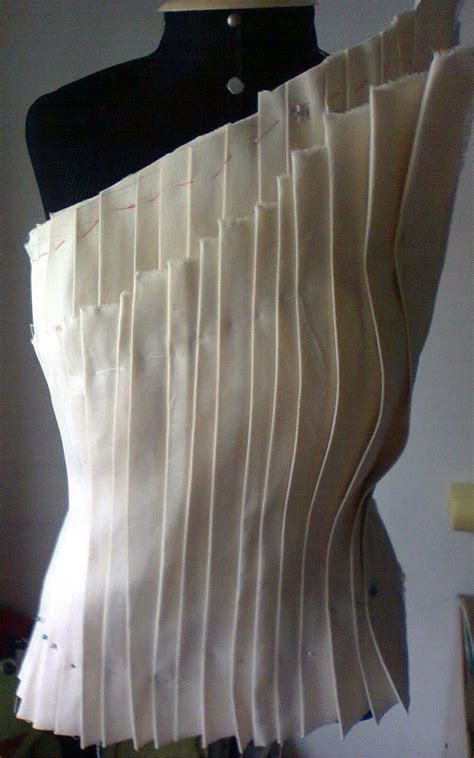 Draping Patterns - structural pleats draping on the stand fashion design