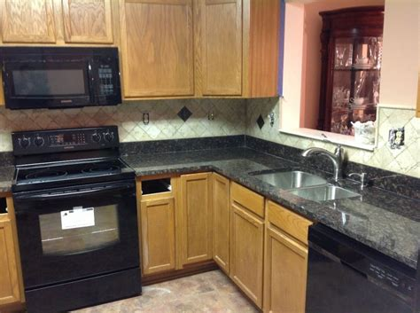 Kitchen Counter Backsplash Ideas by Black Countertop With Oak Cabinets Search