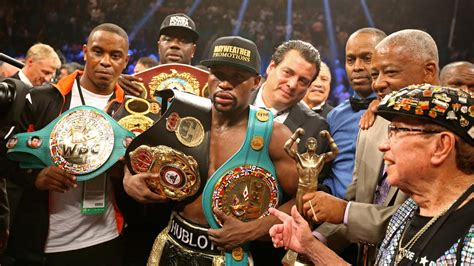 floyd mayweather  giving    title belts