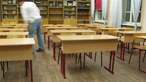 Rows Of Chairs And Tables Inside Empty Physics School