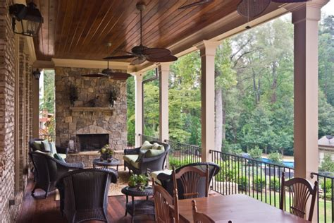 Outdoor Living Room Design With Wooden Furniture And Wall