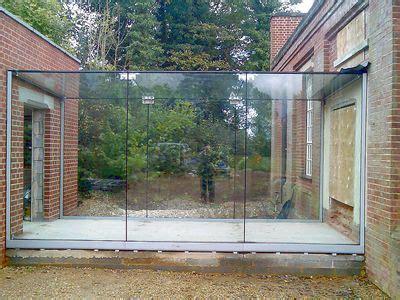 glass link  bldgs glass walkway glass house