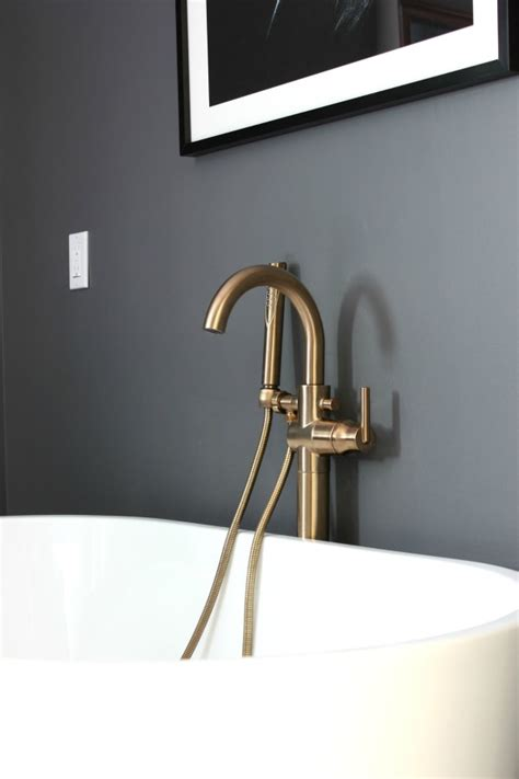 delta floor mount tub filler specs master bathroom chagne bronze faucets and fixtures