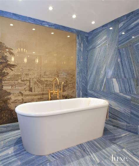 master bathroom boasts blue marble   tub