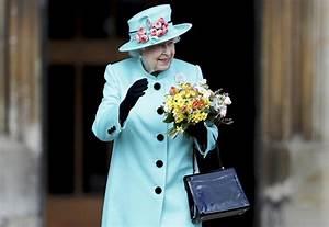 Queen Elizabeth Ii Drives A Jaguar Back From Church