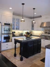 black kitchen island hanging lights over island in kitchen