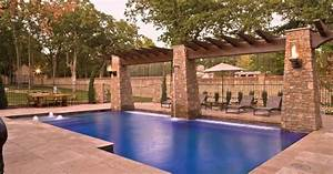 Swimming Pool with Covered Patio - A trio of stacked-stone ...