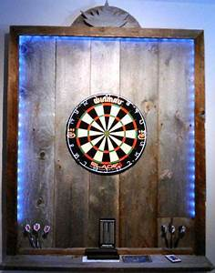 11 crafty dartboard surrounds clever ways to protect With what kind of paint to use on kitchen cabinets for wall art man climbing rope