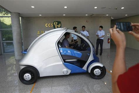 korea armadillo electric technology vehicle parking experimental science institute south folds easy foldable visitor advanced takes photographs nbcnews september