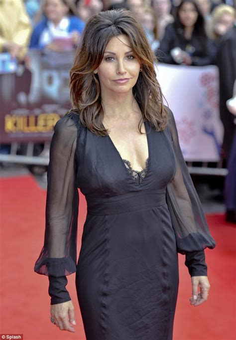 Gina Gershon shows off her impressive shape in plunging