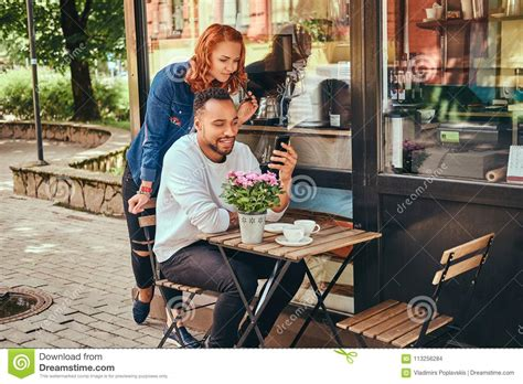 Likely the best espresso i've had in oklahoma. A Couple Dating Drinking Coffee, Sitting Near The Coffee Shop. Outdoors On A Date. Stock Photo ...