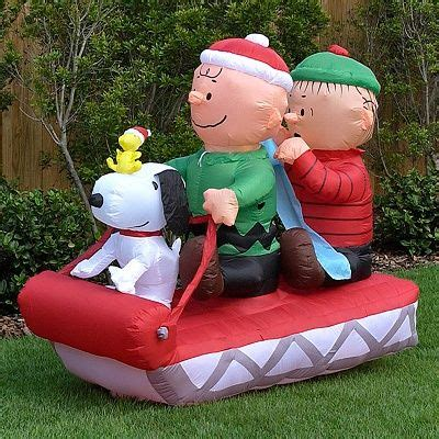 yard inflatables  contained snoopy   friends