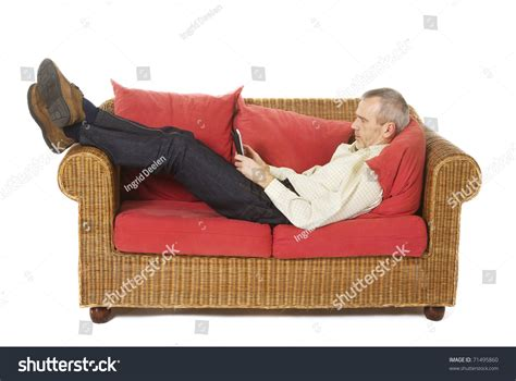 Lazy Man Laying On Couch Reading Stock Photo 71495860