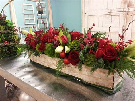 christmas centerpiece  roses amaryllis winterberry  tulips christmas centerpieces pinterest christmas centerpieces christmas