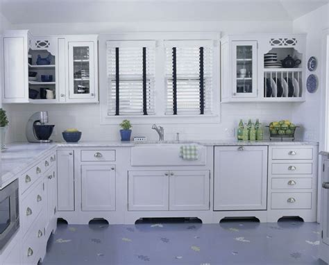 pictures of kitchens with white cabinets and black countertops white kitchen hints of blue kitchens 9945