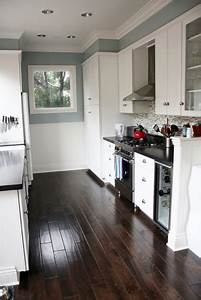 blue gray kitchen with black counter tops and white cabinets With kitchen colors with white cabinets with printed wood tiles wall art