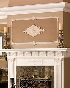 Wall decor with medallion above fireplace mantel