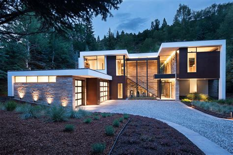 Dramatic Stone And Glass Home In Aspen Surrounded By Forest