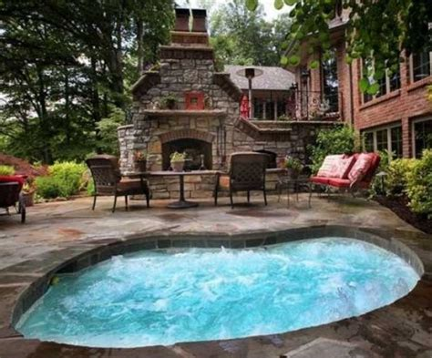 large in ground tub large in ground hot tub in patio with fireplace home interior exterior