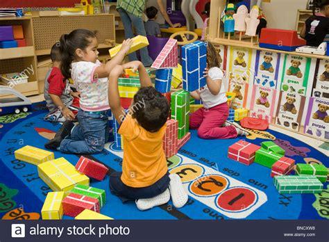 preschool kids playing preschool children with blocks on the floor stock 316