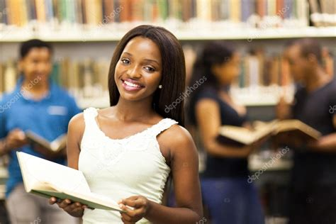 Beautiful African American College Girl In Library Stock