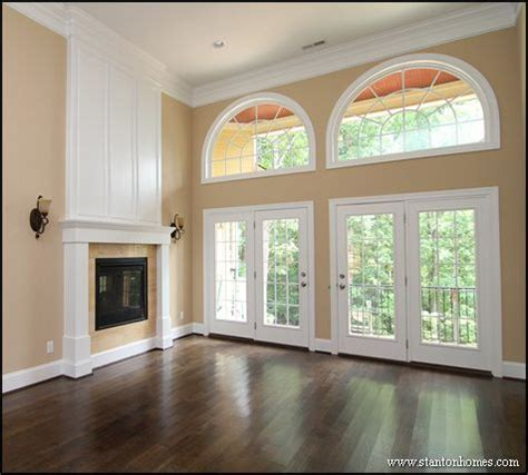 fireplace doors in this photo wainscoting panels above the see through