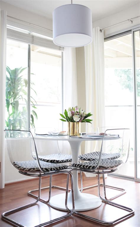 Clear Chairs That Have Minimal Visual Weight And A Round