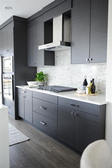 dark gray flat front kitchen cabinets  gray mosaic