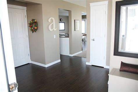dark wood floors white trim and doors wall color it s
