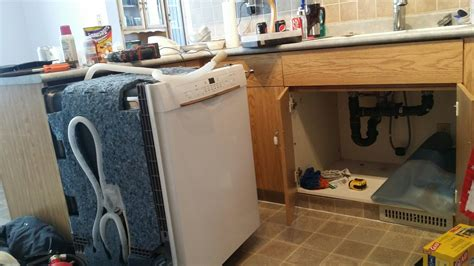 removing kitchen cabinets for dishwasher how to install dishwasher that is few cabinets away from