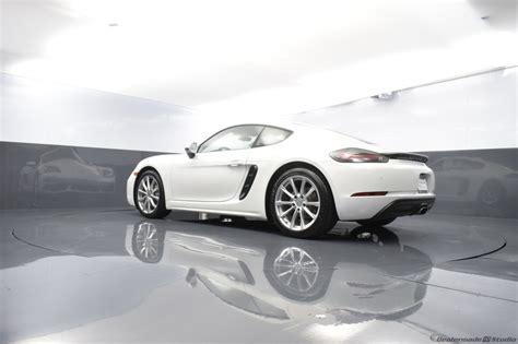 The 2018 porsche 718 cayman adds customization options that includes a gloss black rear spoiler, contrasting colored stitching and seat belts. Certified Pre-Owned 2018 Porsche 718 Cayman Base 2D Coupe White in West Palm Beach #PC-PF27003 ...