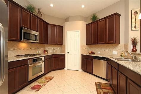 cherry wood cabinets with granite countertop cherry kitchen cabinets with granite countertops