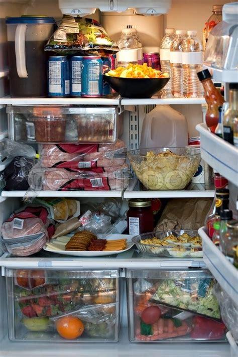 An open refrigerator door showing a full stocked fridge