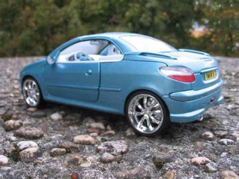peugeot 206 cc tuning peugeot 206 cc miniature bleue jantes chromees solido 1 18 voiture miniature
