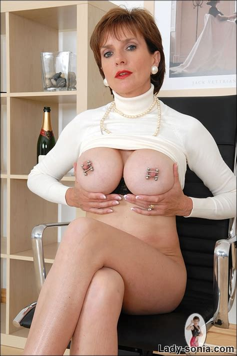charming lady sonia showing the big boobs with exciting pierced nipples