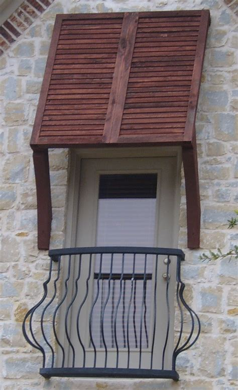 bahama shutters mounted   awning outdoor wood