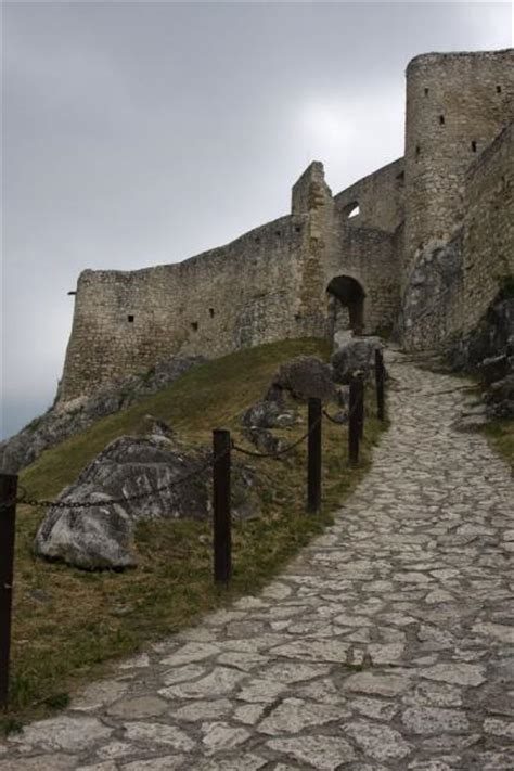 Stone Path Leading Up To The Entrance Gate Of The Upper