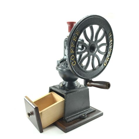 Things to consider when buying a manual coffee grinder. Hand Coffee Grinder made in the style of colonial America