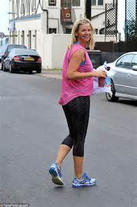 Zoe Ball shows off her toned figure as she steps out for a ...