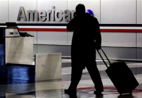 american checked bag fee airline american airlines 2008 carry on bag n a1st checked bag photo 6138602 98284