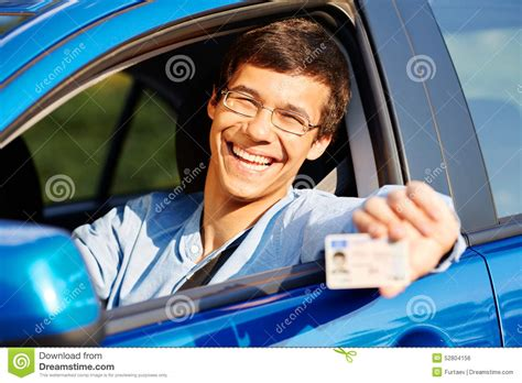 Guy Shows Driving License From Car Stock Photo