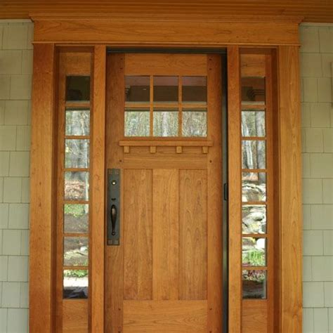 cherry entry door accented  craftsman hardware